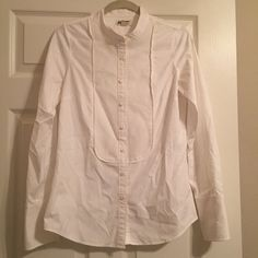 White J. Crew button down blouse. White J. Crew button down blouse. With front and cuff detail. Like new only used a few times. Smoke free home. No stains or rips. 100% Cotton. J. Crew Tops Button Down Shirts