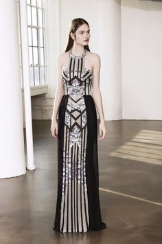 This halter, sequin gown is a gorgeous look for attending any black tie wedding! Shop this dress at Farfetch.com