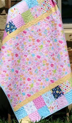 """This listing is for a Tumbler Charm Showcase Quilt Kit featuring Wildflower Meadow by Melley and Me for Riley Blake Fabrics. Quilt will measure approximately 38"""" x 48"""" Kit includes: Tumbler Charm Showcase by Sunnyside Designs 3 Charm Packs 24 inches of """"focus fabric"""" 13 inches for binding, (seen on quilt) 54 inches for backing, (seen on quilt) All fabrics featured in the quilt shown are the same prints you will receive in your kit. With all coordinating fabric this quilt will turn out…"""