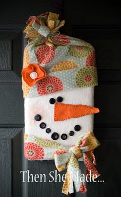 Snowman craft.  Cut an empty cardboard bolt from fabric, in half.  Fold a piece of cotton batting (warm and natural) in half and hot glue around bold.  Cut and fold up a piece of fleece.  Glue to head for hat.  Cut carrot nose from felt and can add blanket stitch around edges.  Glue on different size buttons for face. Cut hole in back for hanging.