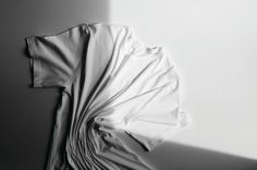 Play with scrunching, wrinkling + shadow/light. Sunspel + Cereal   Cereal Magazine