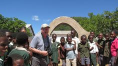 Retiree Cliff enjoying time with some Zimbawean school