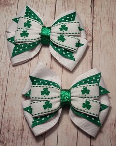"These adorable bows are made with 1 1/2 inch wide white, 1 inch green with white polka dots, and 5/8 inch wide sparkly shamrock grosgrain ribbon. The finished bow measures approximately 4"" wide by 3"" high. These bows are great worn individually as a pullback or a great"