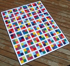 Four Square Free Quilting Pattern - Make a gorgeous lap quilt pattern with a geometric and colorful design.