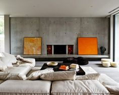 Despite all this concrete, they've sure managed to make this look like the coziest spot to be. Combining the warm whites, browns and oranges instantly warms up the otherwise cool concrete.
