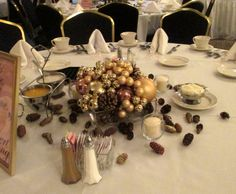 Low Centerpiece with Mounded Gold Ornaments and Pinecones.