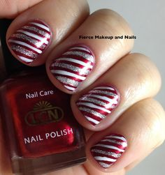 wrapping paper inspired mani - base is LCN Red Ruby. The stripes were free handed with striping polishes in white and silver glitter.