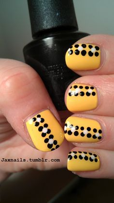 Pastel yellow with black and white dots/flowers.