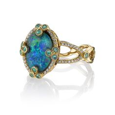 Jewelry Diamond : 18K Yellow gold ring featuring a 2.40 ct. Black Opal with 0.68 ctw. of Diamonds.