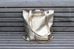 Goldener Lederbeutel // golden leather bag by ElektroPulli via DaWanda.com