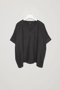 COS image 2 of Silk v-neck top in Black