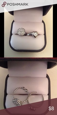 Toe rings bundle of 2 NWOT Brand new high end toe rings bundle of 2 never used. Didn't come with tags. Cubic zirconia stones. Adjusts to fit on toes. Silver tone high end quality. Sold for much more. Last 2 left sold as a bundle. Cubic zirconia Jewelry Rings
