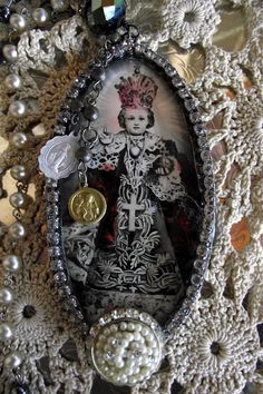 Interesting mix of crochet, paper, and jewelry bits.