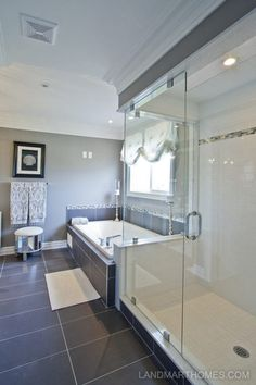 This bathroom features a glass door shower for a modern look. Meadowlands by Landmart Homes in Ancaster, Ontario. #hamont #bathroomideas