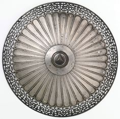 Indo-Persian shield boss, 16th to 17th century, probably Ottoman, steel, Diam. 9 in. (22.9 cm); H. 4 5/8 in. (11.8 cm), Met Museum.