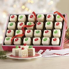 Very Cherry and Green Apple Jelly Belly jelly beans are perched atop bite-sized layer cakes with vanilla creme fillings to complement their signature flavors.