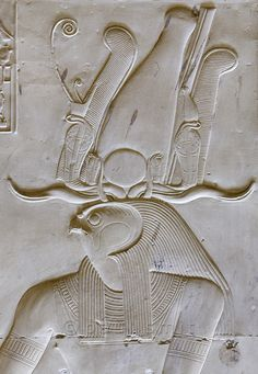 Falcon headed Ra Horakhti at the Abydos temple of Seti I, wearing the Atef crown of Osiris with Amun Ra's spiraling horns and 4 Ouret cobras around a solar disk. The word 'ram' comes from the Roman's name for Amun Ra, 'Ra-Amun'. Photography by Paul Smit Egyptian Mythology, Ancient Egyptian Art, Ancient Aliens, Ancient History, Egyptian Hieroglyphs, Nasa History, European History, Ancient Greece, American History