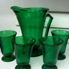 Green depression glass pitcher and juice glasses.