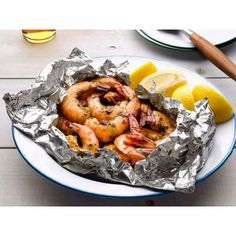 Grilled Shrimp in aluminum foil. 1 pound shrimp, 1/2 stick butter, 1 cup chopped parsley, 2 chopped garlic cloves , juice from one fresh lemon, pinch of red pepper flakes. Divide into 2 packets and grill for 5 minutes!