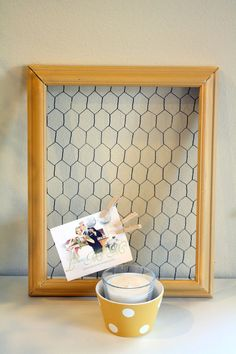 awesome way to corral tidbits of paper that wants to be displayed. Lemonademakinmama.com