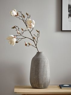 Soft, feminine and perfect for spring, our elegant magnolia spray features blush flowers for a beautiful pastel accent in your living space. Display in a floor vase, or trim and pair with other