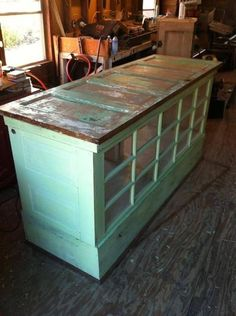 Kitchen island made from old doors, I would seal the top and fit a custom made butcher wood on top. by sarah.koch.94