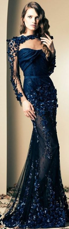 Gorgeous evening gown in dark blue with beautiful intricate design. See through material
