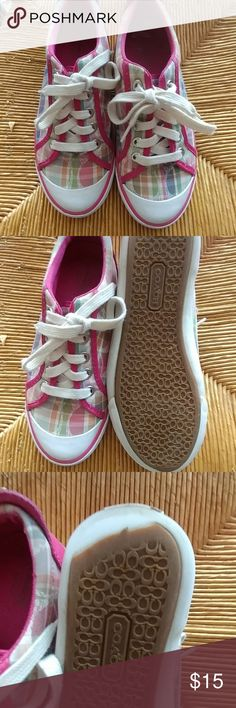 Coach sneakers Great condition,  3rd pic shows a missing part on the sole,  got them like that.  Spring perfect  Get the look with out breaking the bank True to size Coach Shoes Sneakers