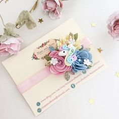 Beautiful unicorn flower handmade headband. Material: Made from 100% wool felt and glitter fabric and finished with a clay unicorn charm and delicate leaves and flowers. Size: Measures approximately 3 Available on your choice of the following: A regular 15mm soft stretch headband