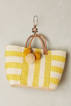I'm cheering for this tote to go to a spa beach with me - pom poms! #anthroregistry Pampero Tote - anthropologie.com