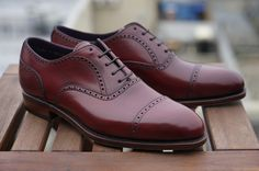 Carmina for Epaulet ruby shell cordovan.  these were the only shoes my father would wear!!!!!
