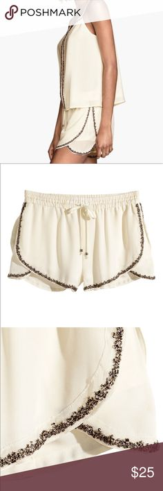 h&m • beaded shorts condition: new with tags retail: $29.95 plus tax  Short shorts in airy woven fabric with wrapover panels at sides and beaded trim. Elasticized drawstring waistband and jersey lining.  100% polyester. Machine wash cold   NO TRADES  trusted seller for years • ships quickly great feedback • REASONABLE offers welcome H&M Shorts