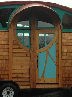 Awesome Custom Made Windows .... I love how the copper awning shelters the front door.