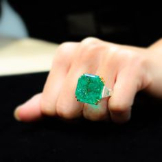 31.49 carats columbian emerald and diamond ring