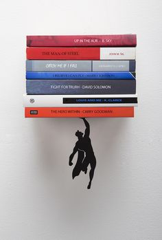 "Clever superhero bookshelf ""saves"" books from falling. #design"