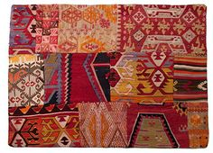 Patch work Kilims by the loaded trunk