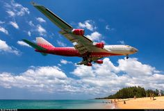 The Tiger arriving over the beach in Phuket. EI-XLD. Boeing 747-446. JetPhotos.com is the biggest database of aviation photographs with over 3 million screened photos online!