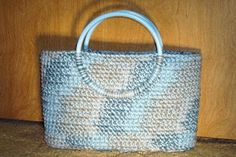 "Basic oval bag - approximately 13 1/2"" x 8"" x 3 1/2""; 9 oz. yarn; plastic canvas for bottom liner; handles; hook size L, done in SC stitch    #crochet #bag"