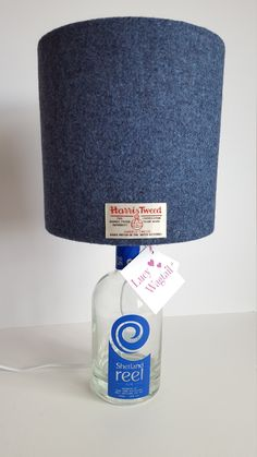 Gin Bottle Lamp, complete lamp including bottle, Denim Blue Harris Tweed lampshade and push in bottle adaptor, Scottish Gift by LucyWagtail on Etsy Bottle Lamp Kit, Bottle Lamps, Scottish Gifts, Gin Bottles, Fathers Day Presents, Harris Tweed, Light Fittings, Lampshades, Save Energy