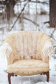 not sure why, but i just love this chair ... why is it out in the snow?