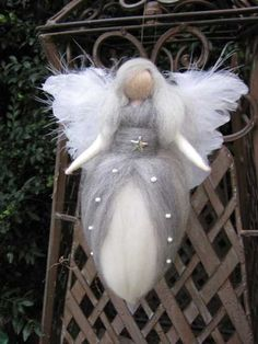 Waldorf inspired Angel made out of high quality merino wool in magical colours with an eye for details!    Christmas Angel in white and gray with a