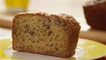 Sour cream guarantees a moist and tender loaf.  And bananas are sliced instead of mashed in this recipe, giving a concentrated banana taste in every bite.