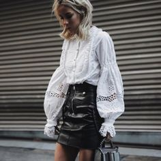 The bib ruffled top has gone from a high-fashion piece to a wearable one with a touch of sophistication.