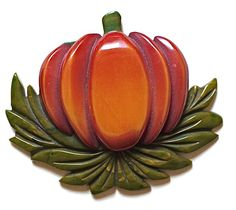 I want to make some sort of pumpkin broach for the wedding party to wear (maybe with purple tulle on the back). Would love ideas for that!
