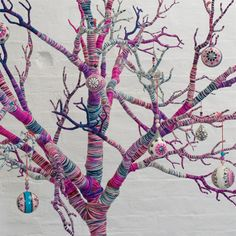 Uzbek Baubles - I may have to learn how to do these and make (yet another) Christmas tree this year! Love the yarn wrapped tree, as I'm not one of those who can do guerilla knitting or crocheting! The (How To Make Christmas Baubles) Noel Christmas, Modern Christmas, All Things Christmas, Bohemian Christmas, Christmas Tree Branches, Purple Christmas, Coastal Christmas, Holiday Tree, Xmas Tree