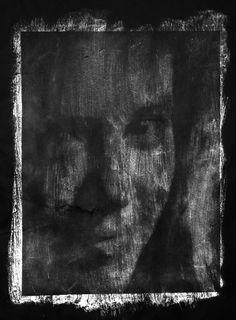 A distressed gum bichromate print - white pigment on black paper