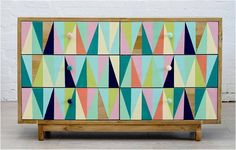 CHEST IN A TRIANGLE PTTERN WITH BRIGHT SHADES ND WOODEN FRAMES LIL BIT FUNKY