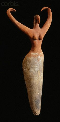 Egyptian Predynastic Female Figurine dating to circa 3650-3300 B.C. Terracotta, 11 1/2 in. (29.3 cm) high. Located in the Brooklyn Museum