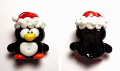 A silly lampwork glass penguin by Heather Sellers.