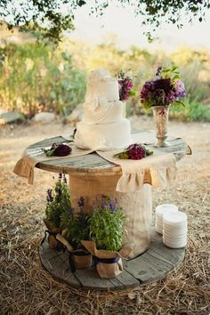 I like the potted lavender with the burlap and ribbon- pretty for the aisle!